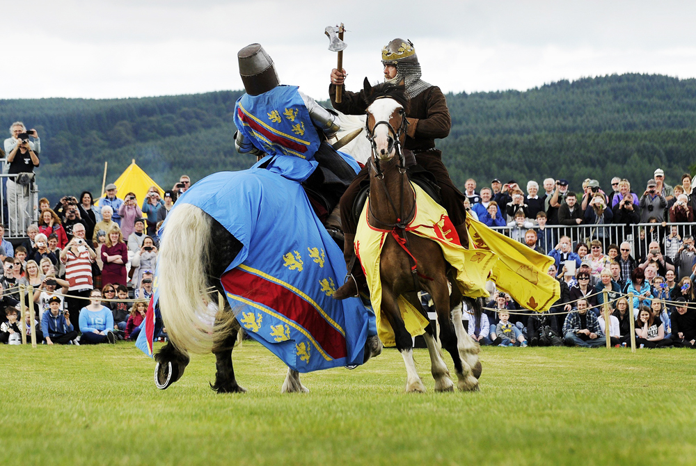 Image: Actors take part in a re-enactment to commemorate the 700th anniversary of the Battle Of Bannockburn