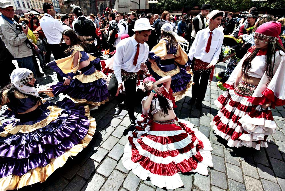 Participants of the Khamoro World Roma Festival dance through th